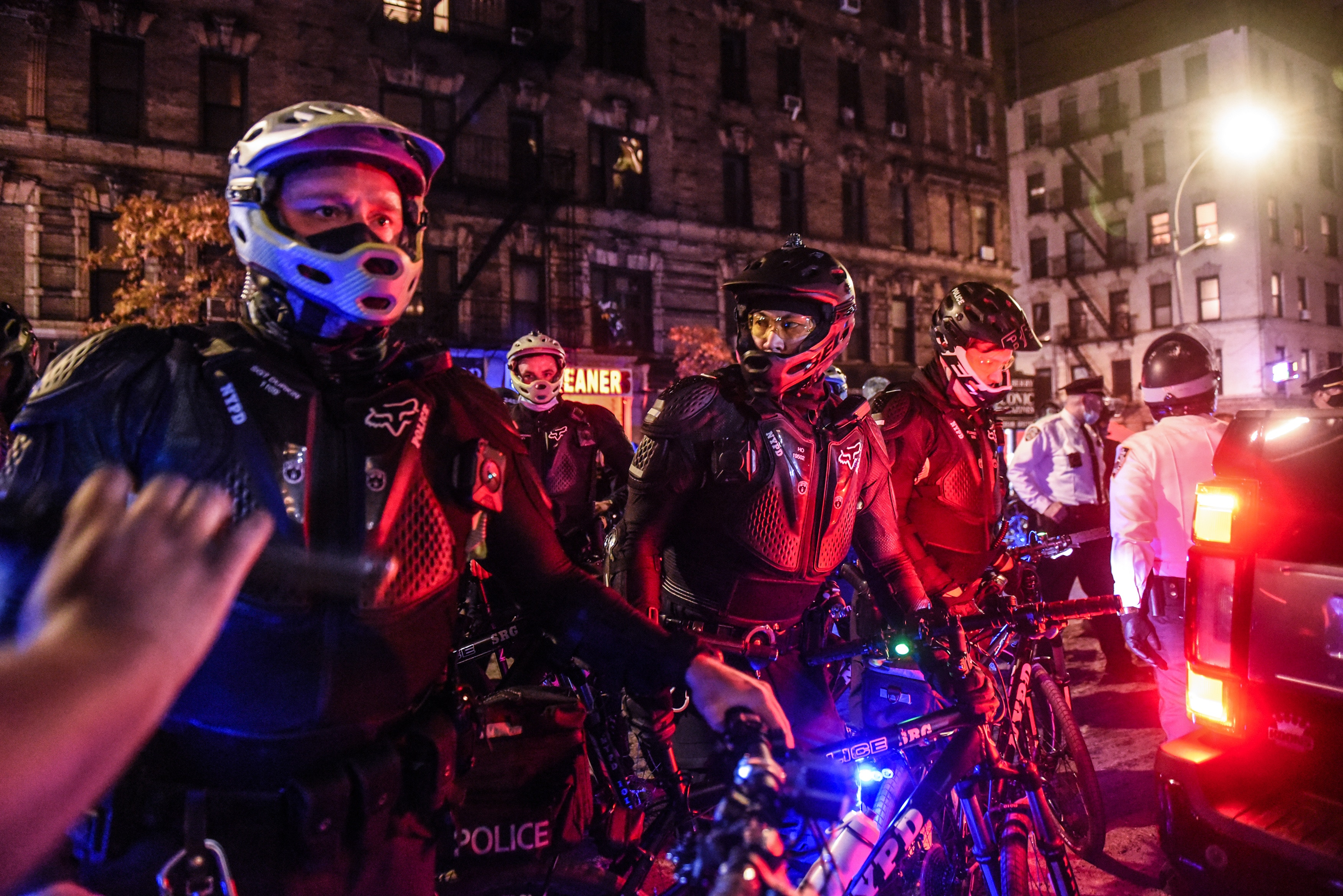 New York Police Department (NYPD) officers stand with bicycles at a protest during the 2020 Presidential election in New York, U.S., on Thursday, Nov. 5, 2020. At least three protests are planned Thursday evening in New York City, including a march near an area that saw a confrontation between police and demonstrators on Wednesday night that resulted in more than two dozen arrests. Photographer: Stephanie Keith/Bloomberg via Getty Images