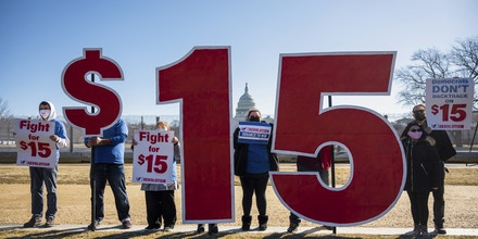 UNITED STATES - FEBRUARY 25: Activists with Our Revolution hold $15 minimum wage signs outside the Capitol complex on Thursday, Feb. 25, 2021, to call on Congress to pass the $15 federal minimum wage hike proposed as part of the COVID relief bill. (Photo By Bill Clark/CQ-Roll Call, Inc via Getty Images)