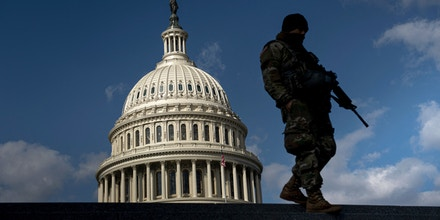 A member of the National Guard patrols the grounds of the US Capitol on March 4, 2021, in Washington, DC. - Lawmakers and staff were advised to stay away from the US Capitol after the FBI and Homeland Security Department warned that violent militia groups and QAnon followers had discussed attacking the legislature on or about March 4. The FBI-Homeland Security bulletin said extremists are still motivated by unfounded Republican claims of widespread voter fraud in the November presidential election won by Democrat Joe Biden. (Photo by Brendan Smialowski / AFP) (Photo by BRENDAN SMIALOWSKI/AFP via Getty Images)