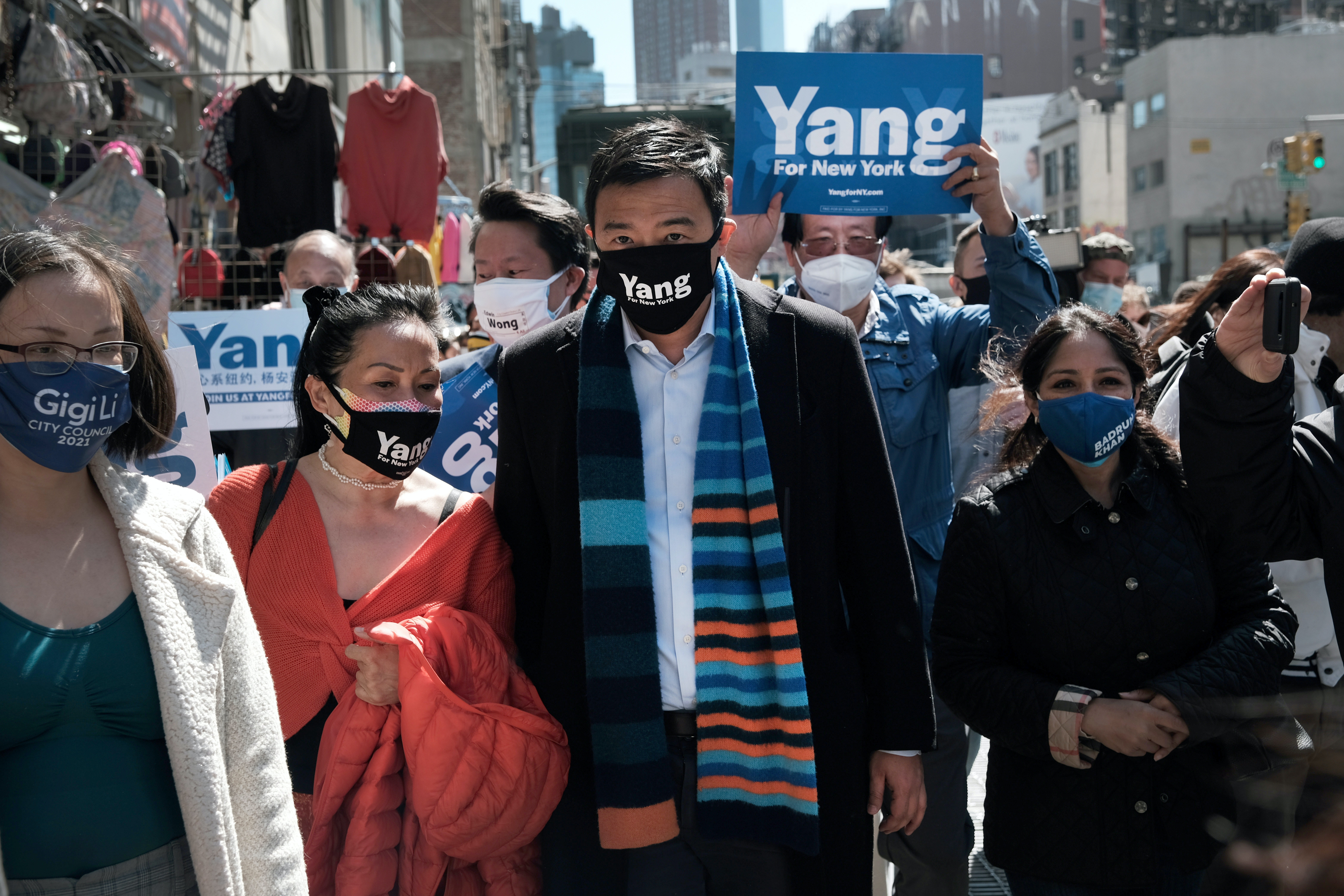 New York Mayoral Candidate Andrew Yang speaks to members of the media along Canal Street in Chinatown on April 05, 2021 in New York City.