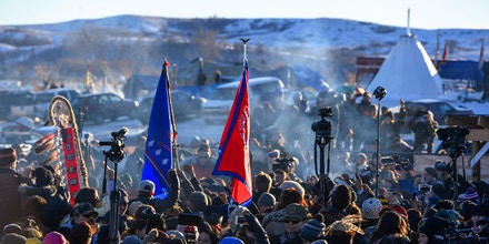 CANNON BALL, NORTH DAKOTA - DECEMBER 4: Native americans celebrate their victory after Sioux Chief Arvol Looking Horse announced, to members of over 300 nations,  that the US Army Corps of Engineers will no longer grant access to the Dakota Access Pipeline to put their pipe line on the boundary of the Standing Rock Sioux Reservation at Oceti Sakowin camp on December 4, 2016 in Cannon Ball North Dakota, Colorado. Native Americans and activists from around the country have been gathering at the camp for several months trying to halt the construction of the Dakota Access Pipeline. The proposed 1,172-mile-long pipeline would transport oil from the North Dakota Bakken region through South Dakota, Iowa and into Illinois. (Photo by Helen H. Richardson/The Denver Post via Getty Images)