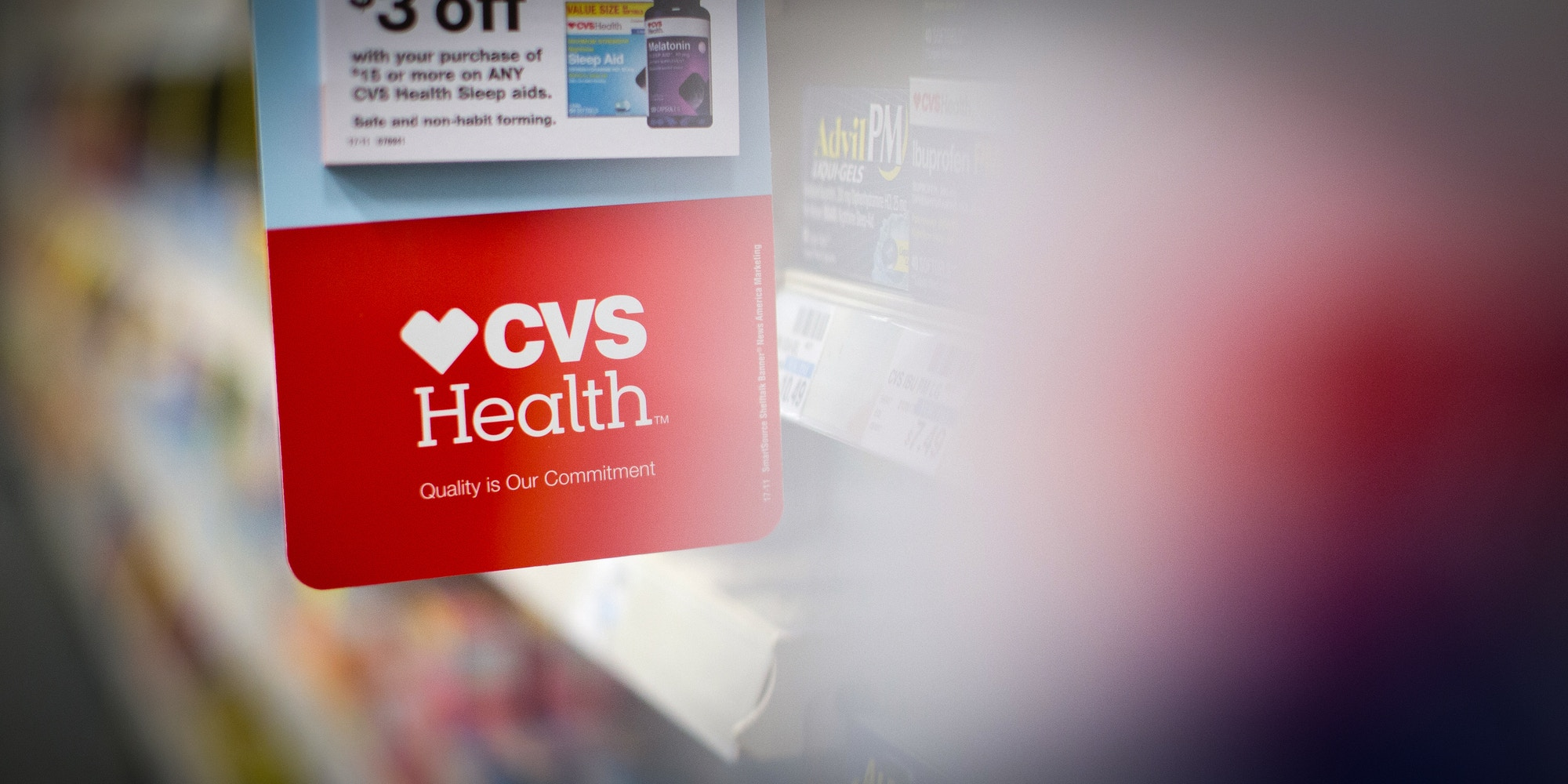 Signage is displayed in an aisle of a CVS Health Corp. store in downtown Los Angeles, California, U.S., on Friday, Oct. 27, 2017. The prospect of Amazon.com Inc. entering the healthcare business is beginning to cause far-reaching reverberations for a range of companies, roiling the shares of drugstore chains, drug distributors and pharmacy-benefit managers, and potentially precipitating one of the biggest corporate merger deals this year. Photographer: Christopher Lee/Bloomberg via Getty Images