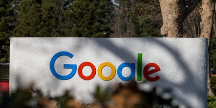 Signage at an entrance to a building on the Google campus in Mountain View, California, U.S., on Wednesday, Dec. 16, 2020.