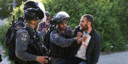 JERUSALEM - MAY 22: Israeli forces intervene in a demonstration by Palestinians on a call from Sheikh Jarrah locals in front of an Israeli forces' checkpoint in Sheikh Jarrah neighborhood of East Jerusalem on May 22, 2021. (Photo by Mostafa Alkharouf/Anadolu Agency via Getty Images)