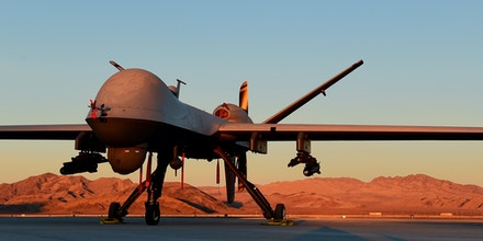An MQ-9 Reaper sits on the flight line at Creech Air Force Base, Nevada, Dec. 17, 2019. The Remotely Piloted Aircraft enterprise is made of Airmen across all career fields to deliver justice to our Nation's enemies 24/7/365. (U.S. Air Force photo by Senior Airman Haley Stevens)