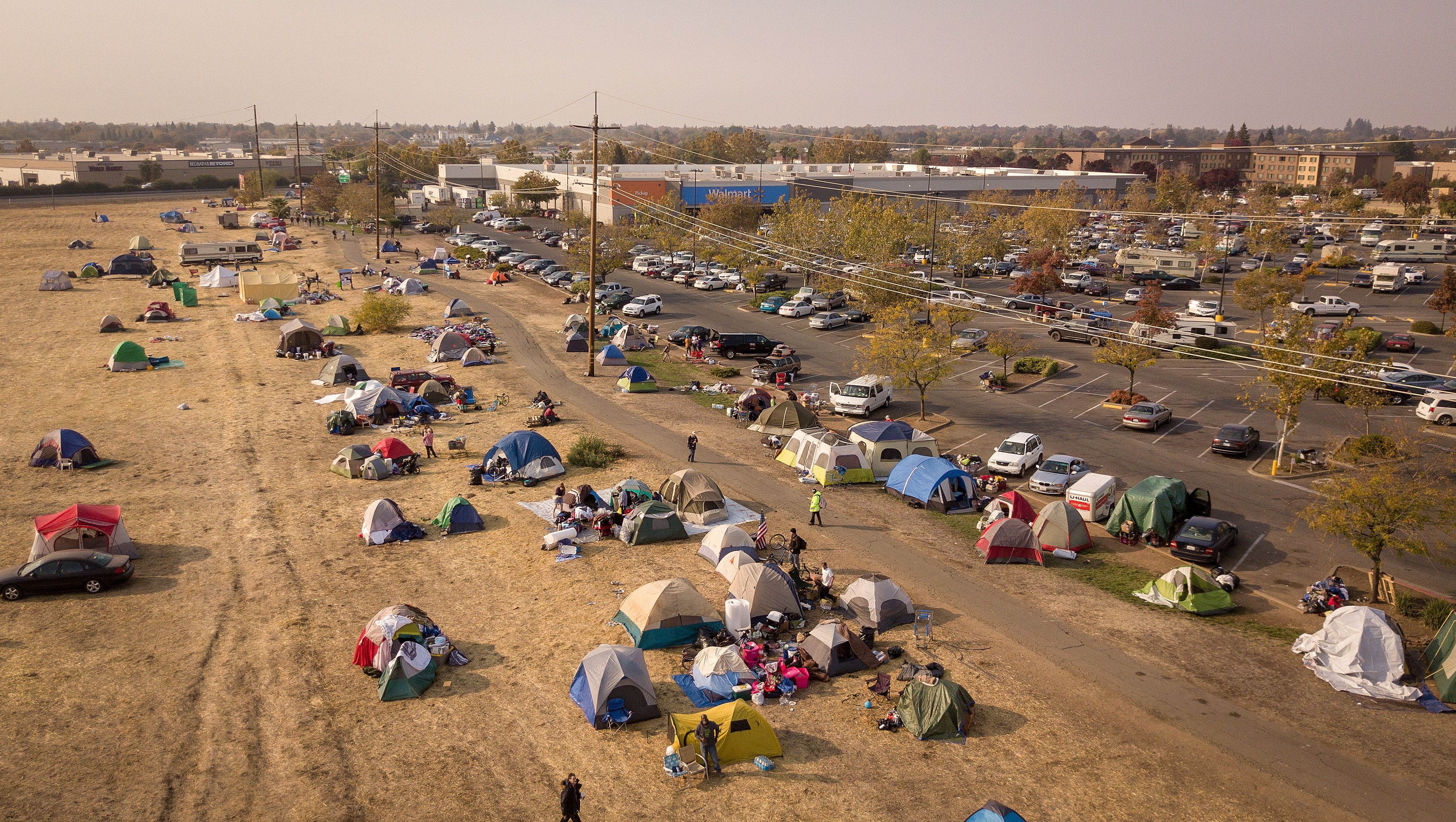 CHICO, CA - NOVEMBER 19: In this aerial photograph, an evacuee encampment is seen at a Walmart parking lot in Chico, California on November 19, 2018. (Photo by Josh Edelson for the Washington Post)