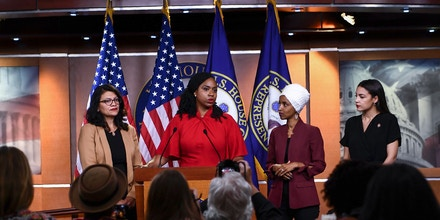 TOPSHOT - US Representatives Ayanna Pressley (D-MA) speaks as, Ilhan Omar (D-MN)(2R), Rashida Tlaib (D-MI) (R), and Alexandria Ocasio-Cortez (D-NY) look on during a press conference, to address remarks made by US President Donald Trump earlier in the day, at the US Capitol in Washington, DC on July 15, 2019. - President Donald Trump stepped up his attacks on four progressive Democratic congresswomen, saying if they're not happy in the United States
