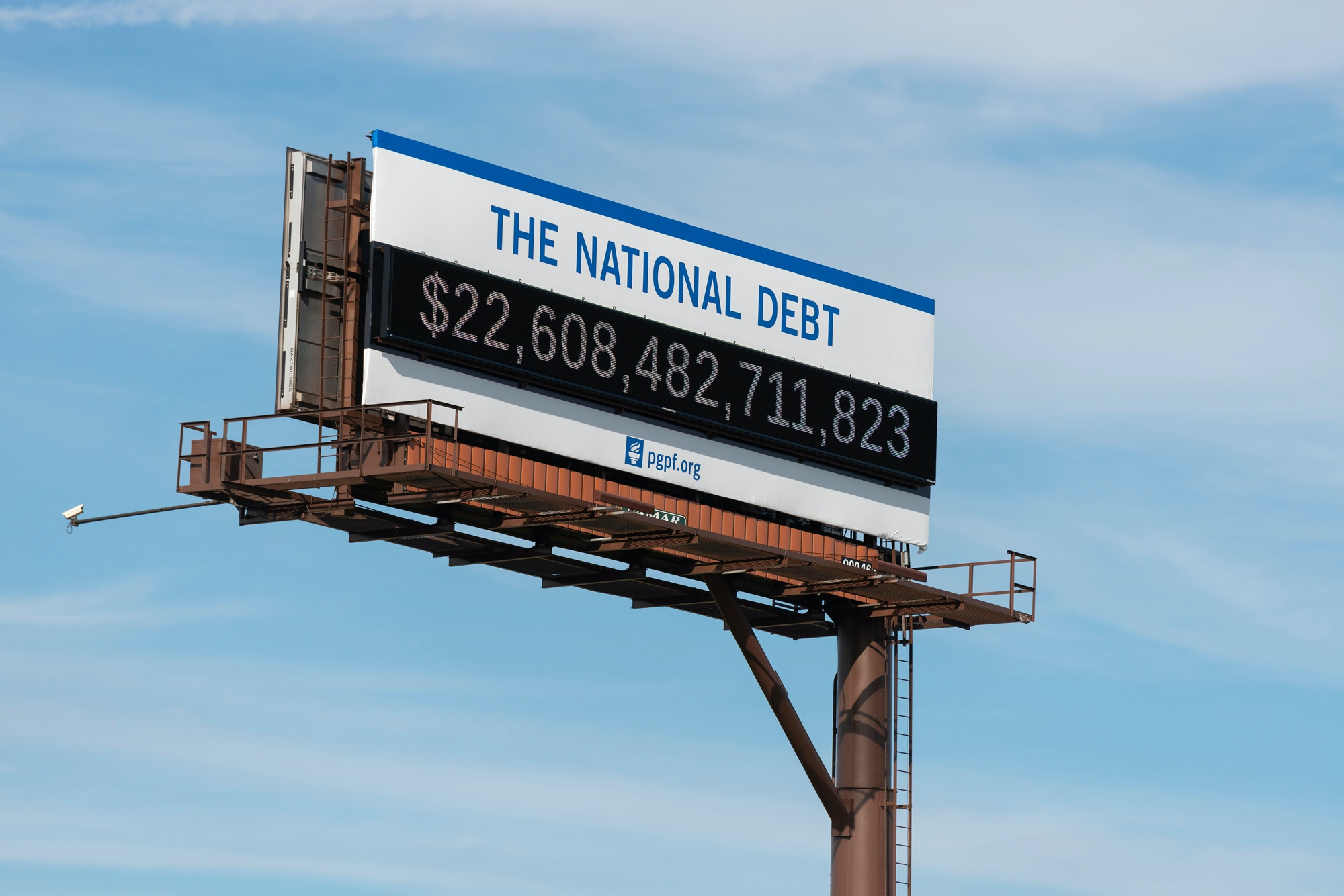 Billboard showing the national debt and each Americans share is displayed on Sept. 24, 2019 in downtown Cleveland, Ohio.
