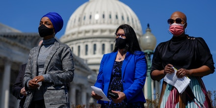 (L-R) Rep. Ilhan Omar (D-MN), Rep. Rashida Tlaib (D-MI), and Rep. Ayanna Pressley (D-MA) attend a news conference outside the U.S. Capitol on March 11, 2021 in Washington, DC.