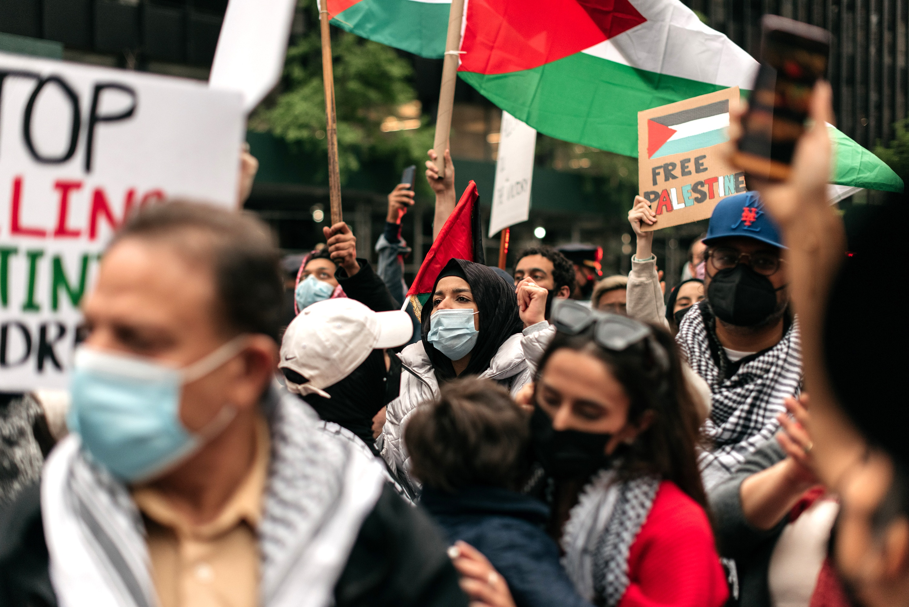 NEW YORK, NY - MAY 11: Protesters demanding an end to Israeli aggression against Palestine rally in Midtown Manhattan on May 11, 2021 in New York City. Recent violence between the Israeli military and Palestinians in Jerusalem has left dozens dead as activists around the world denounce attacks on the city's Al-Aqsa Mosque.(Photo by Scott Heins/Getty Images)