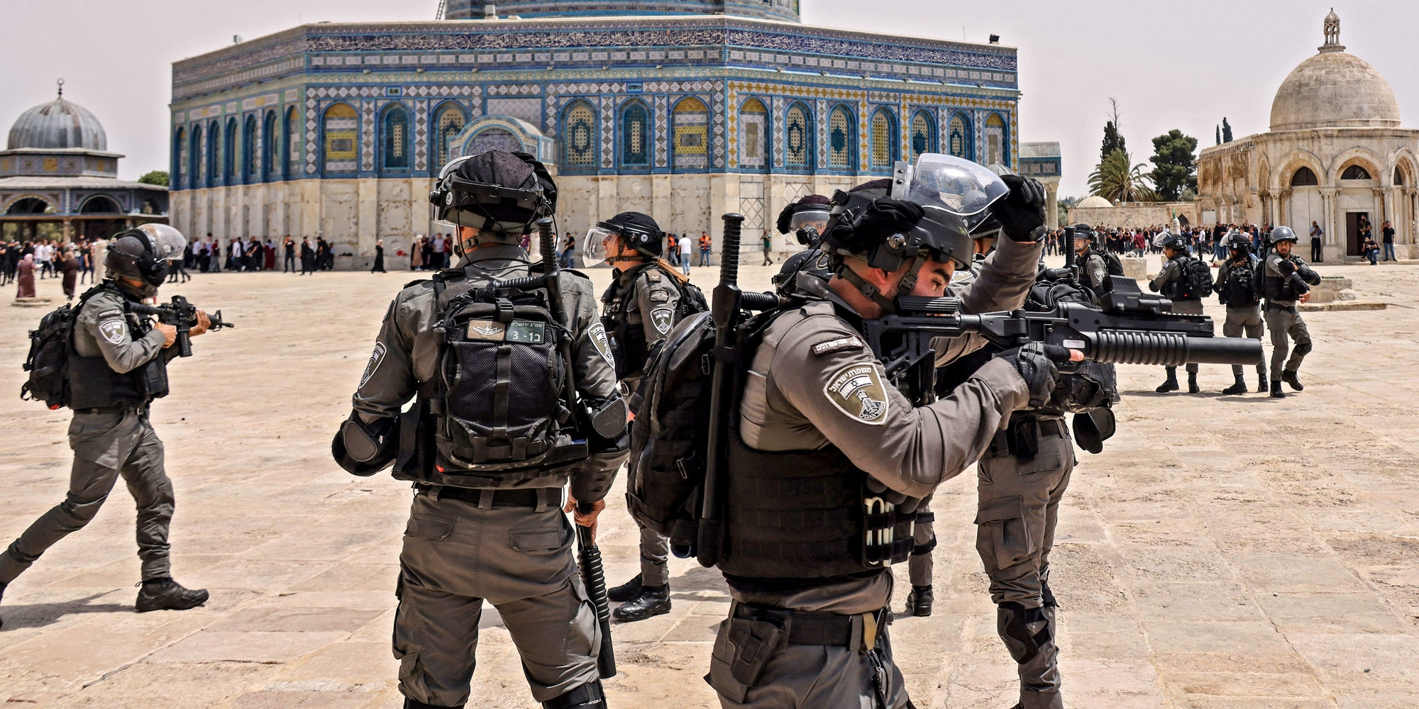 """Israeli security forces and Palestinian Muslim worshippers clash in Jerusalem's al-Aqsa mosque compound, the third holiest site of Islam, on May 21, 2021. - Fresh clashes between Palestinians and Israeli police broke out at Jerusalem's Al-Aqsa mosque compound today, in the latest unrest at the sensitive religious site, AFP journalists and police said. Israeli police spokesman Micky Rosenfeld said officers were targeted by Palestinians who threw stones and had begun """"riot"""" suppressing measures. AFP reporters said fierce clashes were ongoing at the site between police and Palestinians. (Photo by AHMAD GHARABLI / AFP) (Photo by AHMAD GHARABLI/AFP via Getty Images)"""