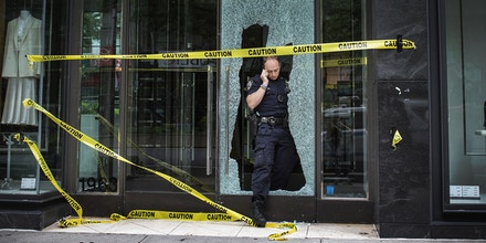 NEW YORK, NEW YORK - JUNE 2: A Police officer leaves from a Zara store after a night of looting due to protest on June 2, 2020 in New York City. Protests spread across the country in at least 30 cities across the United States, over the death of unarmed black man George Floyd at the hands of a police officer, this is the latest death in a series of police deaths of black Americans. The city has declared an 8pm curfew. (Photo by Joana Toro / VIEWpress via Getty Images)