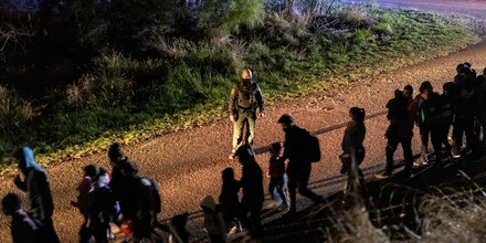 ROMA, TEXAS - APRIL 30: U.S. Border Patrol agents process immigrant families after they crossed the Rio Grande into south Texas on April 30, 2021 in Roma, Texas. A surge of mostly Central American immigrants, especially children, crossing into the United States has challenged U.S. immigration agencies along the U.S. southern border. (Photo by John Moore/Getty Images)
