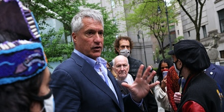 Attorney Steven Donziger speaks to his supporters as he arrives for a court appearance at Daniel Patrick Moynihan United States Courthouse in New York City on May 10, 2021.