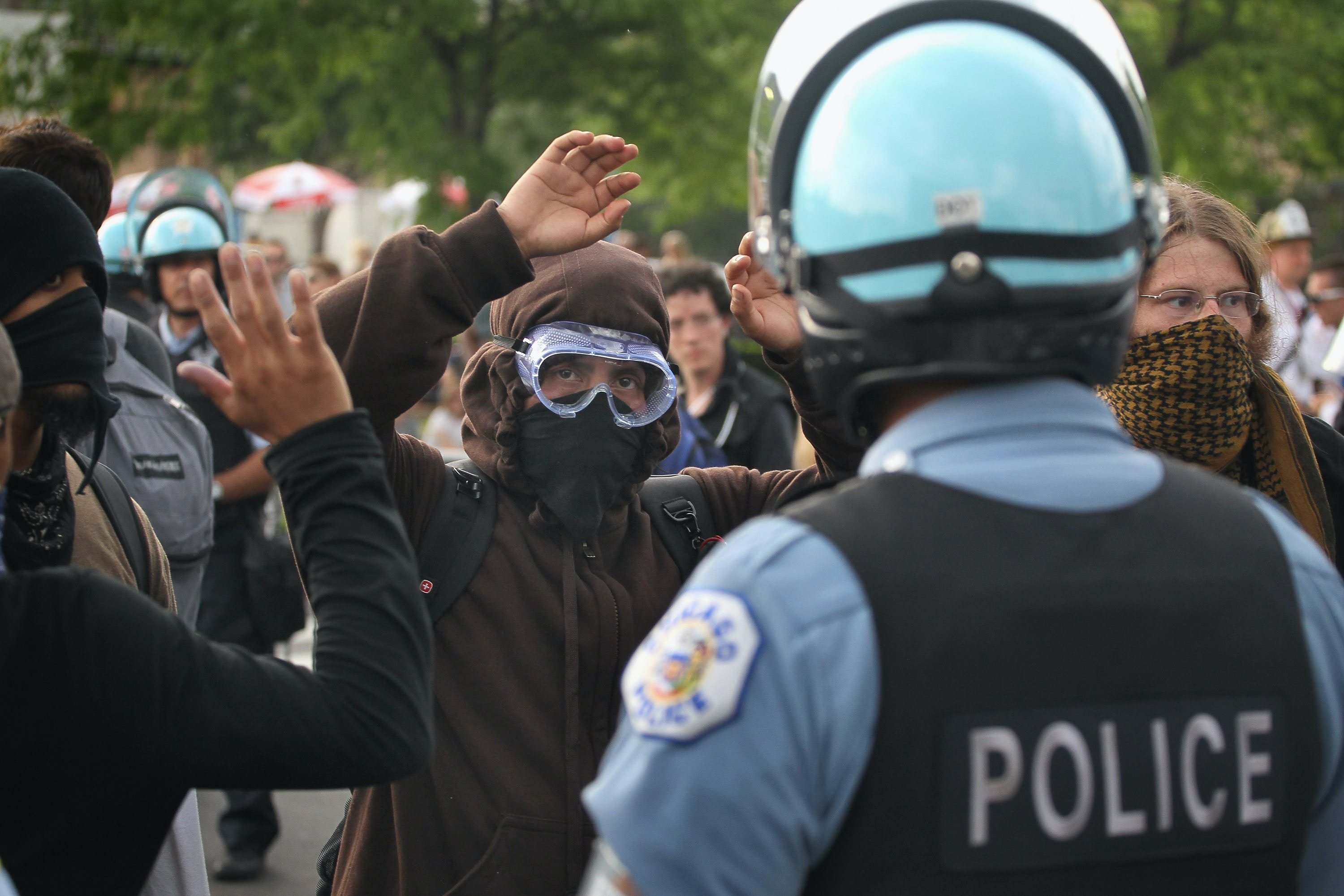 Demonstrators clash with police during a protest against the NATO Summit on May 20, 2012 in Chicago, Illinois.