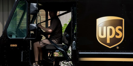 A United Parcel Service of America truck and drop-off box are seen along Milwaukee Avenue in the Old Irving Park neighborhood of Chicago, IL on June 6, 2018.