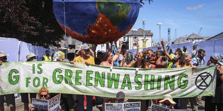 Protesters critical of the Group of Seven countries' environmental policy call for strong action on climate change during a rally in Cornwall, England, on June 12, 2021, as a G-7 summit is under way there. (Kyodo via AP Images) ==Kyodo