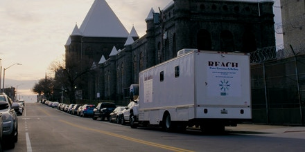 A Project Connections at Re-Entry van is seen parked outside the Baltimore City Detention Center.