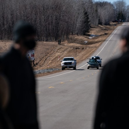 A pickup truck in the distance can be seen surveilling water protectors protesting during the World Water Day rally against the Enbridge Line 3 pipeline in Clearwater County, Minn., on March 22, 2021.