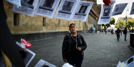 A girl looks at pictures of missing persons hanging from a rope in front of the National Palace during the commemoration of the International Day of the Disappeared in Mexico City, on August 30, 2019. - More than 40,000 people are missing in Mexico, which has been swept by a wave of violence since the government declared war on the country's powerful drug cartels in 2006. (Photo by RODRIGO ARANGUA / AFP)        (Photo credit should read RODRIGO ARANGUA/AFP via Getty Images)
