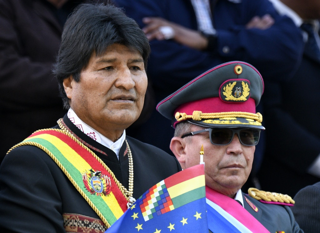 """Bolivia's President Evo Morales and the commander-in-chief of the armed forces, Williams Kaliman, attend the commemoration of the 140th anniversary of the Battle of Calama -in which Chile took control of Antofagasta region, at that time part of Bolivia- in La Paz, on March 23, 2019. - Bolivian President Evo Morales resigned on November 10, 2019, caving in following three weeks of sometimes-violent protests over his disputed re-election after the army and police withdrew their backing. With no sign of violent protests abating, the commander-in-chief of the armed forces, Williams Kaliman, asked Morales """"to resign his presidential mandate to allow for pacification and the maintaining of stability, for the good of our Bolivia."""" (Photo by AIZAR RALDES / AFP) (Photo by AIZAR RALDES/AFP via Getty Images)"""