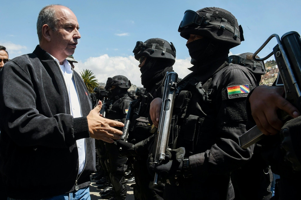 """Bolivian Interim Minister of Government Arturo Murillo (L) greets members of the GAT anti-terrorist unit during its presentation in La Paz, on December 3, 2019. - The interim government of Bolivia on Tuesday activated the GAT anti-terrorist unit with 60 police officers to """"dismantle"""" groups of foreigners who """"are threatening"""" the country's peace, according to the Ministry of Government (Interior) and the Police. (Photo by AIZAR RALDES / AFP) (Photo by AIZAR RALDES/AFP via Getty Images)"""