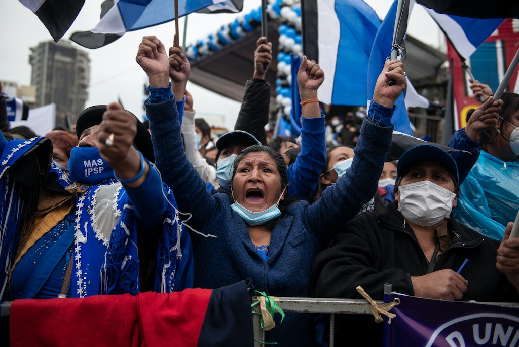 29 March 2021, Bolivia, La Paz: Supporters attend the 26th anniversary of the founding of the ruling party MAS (Movimiento al Socialismo - Movement for Socialism). Evo Morales of the MAS was forced to resign after allegations of fraud against him in the October 2019 elections led to a serious political crisis. Luis Arce won the subsequent elections in October 2020 with over 55 percent of the vote. Photo: Radoslaw Czajkowski/dpa (Photo by Radoslaw Czajkowski/picture alliance via Getty Images)