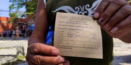 A man shows his vaccination card after receiving the first dose of Cuban vaccine candidate against covid-19 Abdala in Havana, on May 12, 2021. - Cuba began vaccinating against COVID-19 Wednesday with two of its five vaccine candidates in an intervention study mainly in Havana and the provinces of Santiago de Cuba and Matanzas. (Photo by YAMIL LAGE / AFP) (Photo by YAMIL LAGE/AFP via Getty Images)