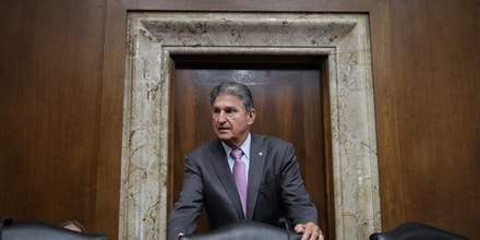 WASHINGTON, DC - JUNE 15: Committee chairman Sen. Joe Manchin (D-WV) arrives for a Senate Committee on Energy and Natural Resources hearing on Capitol Hill June 15, 2021 in Washington, DC. The hearing focused on President Biden's budget request for the Department of Energy for Fiscal Year 2022. (Photo by Drew Angerer/Getty Images)