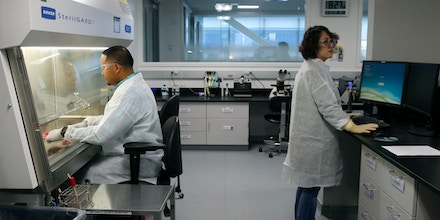Markus Punsulan and Sol Nho work inside one of the labs at the Bayer pharmaceutical and biotech campus in Berkeley, Calif. on Thursday, May 9, 2019. Bayer is breaking ground on its Cell Culture Technology Center. (Photo by Paul Chinn/San Francisco Chronicle via Getty Images)