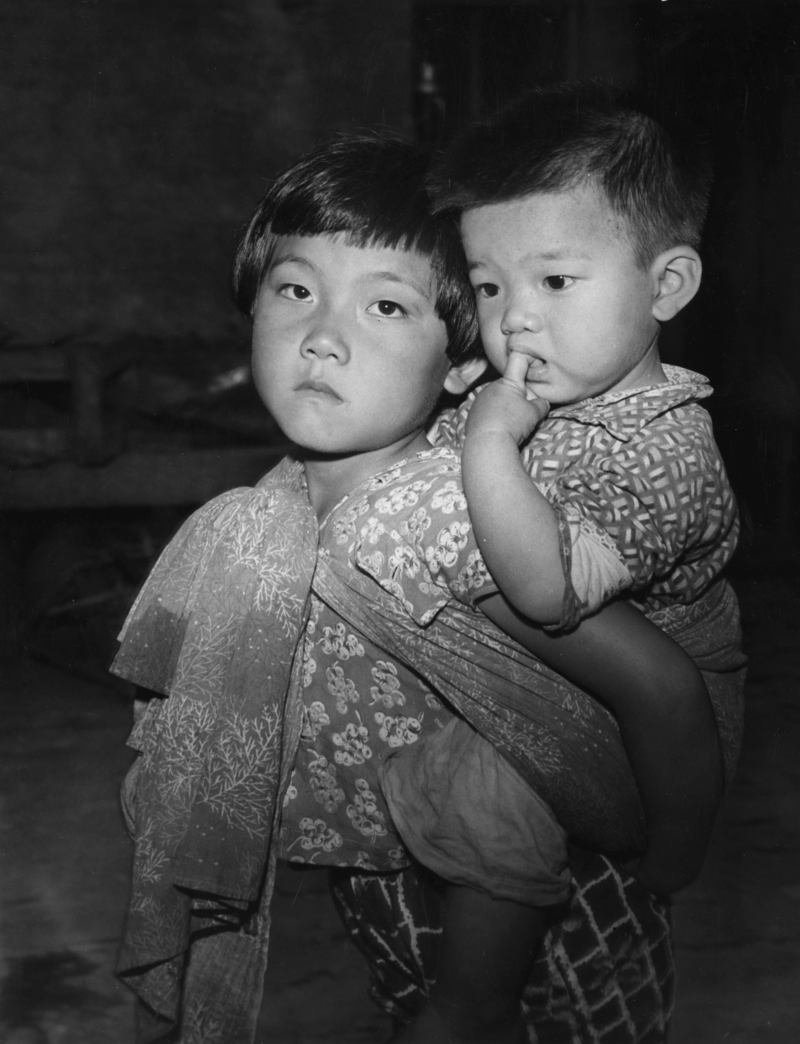 1959: Two Taiwanese children, orphaned when the Chinese Communist army bombed their home in the Nationalist stronghold of the Quemoy islands. Made homeless by the shelling, 6,000 of Quemoy's inhabitants were evacuated to Formosa or Taiwan. (Photo by Keystone Features/Getty Images)
