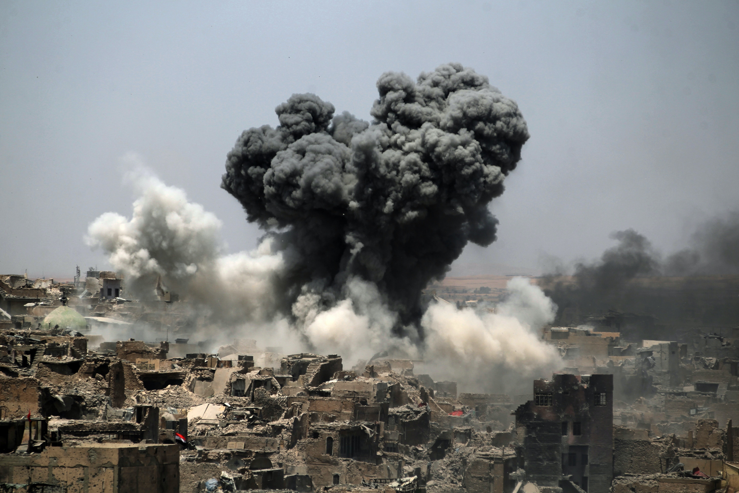 A picture taken on July 9, 2017, shows smoke billowing following an airstrike by US-led international coalition forces targeting Islamic State (IS) group in Mosul. Iraq will announce imminently a final victory in the nearly nine-month offensive to retake Mosul from jihadists, a US general said Saturday, as celebrations broke out among police forces in the city. / AFP PHOTO / AHMAD AL-RUBAYE        (Photo credit should read AHMAD AL-RUBAYE/AFP via Getty Images)