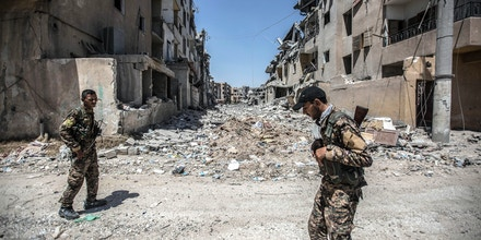SYRIA, RAQQA - AUGUST 04:  Destruction caused by the Islamic State (ISIL) artillery and the US-led coalition airstrikes is seen at the Edikhar housing district near the Nahda neighbourhood in the east of Raqqa city on August 4, 2017. The Battle of Raqqa was launched in June 2017 and is the fifth and final phase of the Raqqa Campaign launched by the Syrian Democratic Forces (SDF) against the occupying ISIL . (Photo by Ahmed Deeb/Getty Images)