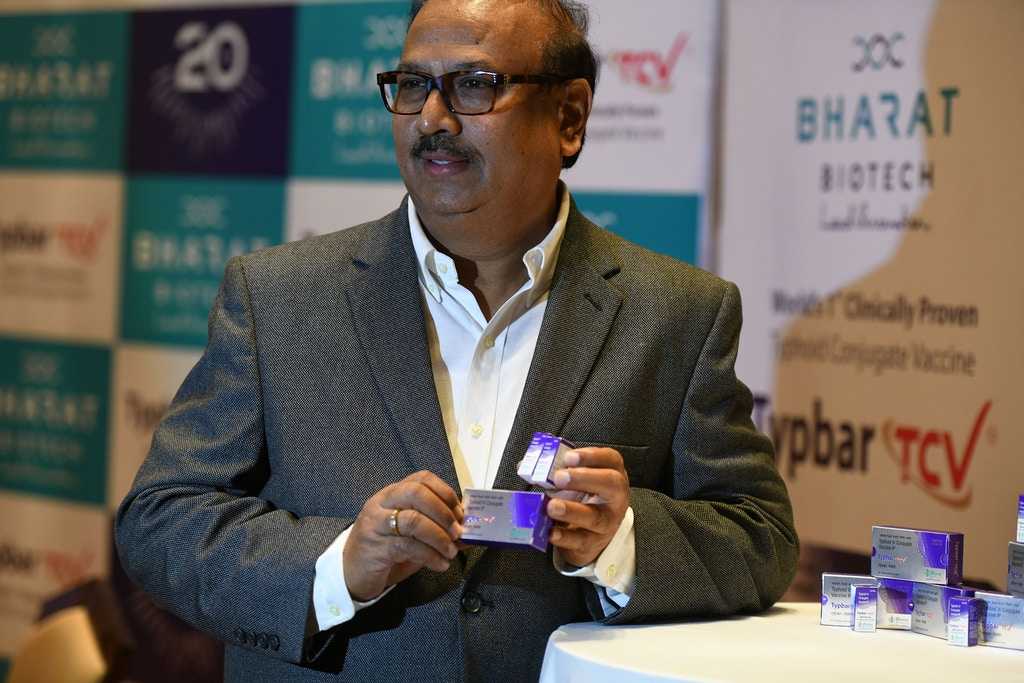 Krishna Ella, chairman and managing director of Bharat Biotech, holds a package of the typhoid vaccine Typbar-TCV during a press conference in Hyderabad on January 3, 2018. Indian biotechnology company Bharat Biotech has said its Typbar-TVC vaccine is the world's first clinically proven Typhoid Conjugate Vaccine against typhoid fever, and that it has received prequalification from the World Health Organisation (WHO) to be administered to children from 6 months of age to adults, and says the vaccine confers long-term protection against typhoid fever. / AFP PHOTO / NOAH SEELAM        (Photo credit should read NOAH SEELAM/AFP via Getty Images)