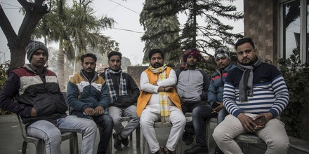 Bajrang Dal leader Pawan Rastogi, center, and his workers, pose for a picture on Jan. 12, 2021, in Shahabad in Uttar Pradesh, India.