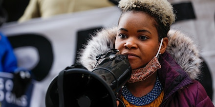 Community activist India Walton holds a megaphone as she campaigns to replace four-term Mayor Byron Brown, in Buffalo, New York, U.S., December 15, 2020. Picture taken December 15, 2020. REUTERS/Lindsay DeDario - RC2IOK9Q0U5R