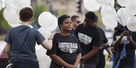 Nerina Joseph looks off as balloons are distributed during a memorial vigil for her son Jeancarlo Alfonso Jimenez Joseph who hanged himself while in ICE custody at the Stewart Detention Center. Attendees flew into Kansas City, MO from all over to be present at the vigil, held on the one year anniversary of his death.