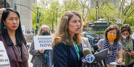Jean Kim, left, listens as her attorney Patricia Pastor, center, speaks to reporters during a news conference, Wednesday, April 28, 2021, in New York.