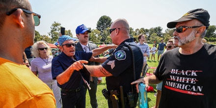 Irvine, CA, Sunday, July 11, 2021 - Police restrain vocal opponents of Representative Katie Porter (D-CA45) following a brief scuffle during a town hall meeting at Mike Ward Community Park. (Robert Gauthier/Los Angeles Times via Getty Images)