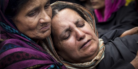 Head of the Association of Parents of Disappeared Persons (APDP) Parveena Ahanger, right, is comforted by an unidentified woman as she cries during a silent protest organized by the APDP on the International Day of the Disappeared in Srinagar, India, Friday, Aug. 30, 2013. The APDP is demanding the setting up of a commission to probe the disappearances of people in Kashmir. According to the APDP, some 8,000 to 10,000 people have gone missing since the beginning of the Kashmir conflict in 1989, after being arrested by Indian security forces and other security agencies. (AP Photo/Dar Yasin)