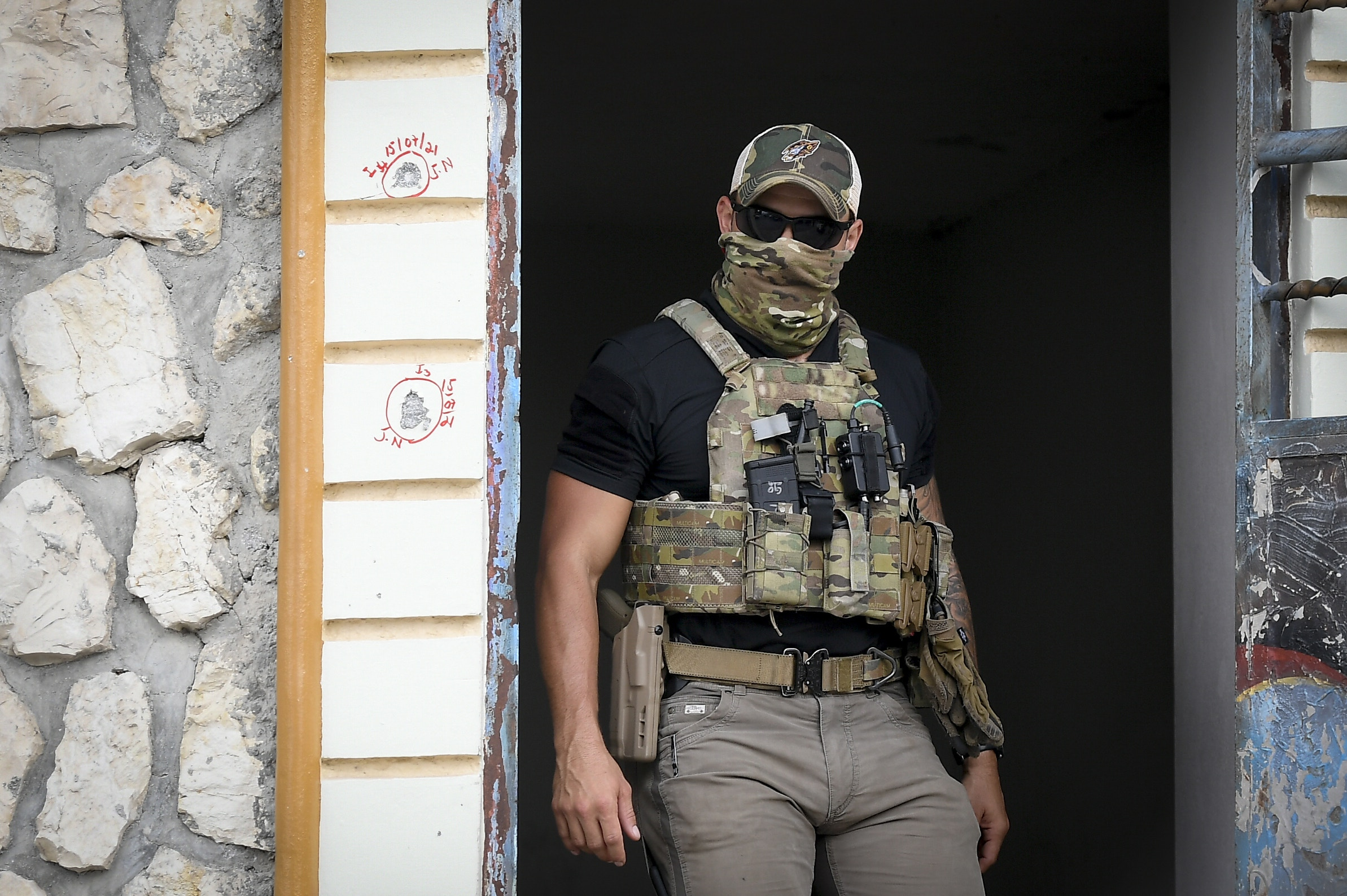 An FBI agent assisting in the investigation over the assassination of Haiti´s President Jovenel Moise leaves Moise´s residence in Port-au-Prince, Haiti, Thursday, July 15, 2021. Moise was assassinated in his home on July 7. (AP Photo/Matias Delacroix)