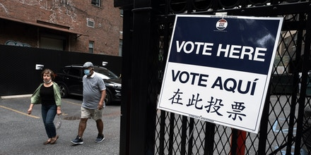 Signs alert people to a voting site in Manhattan as voters head to the polls on June 22, 2021 in New York City.