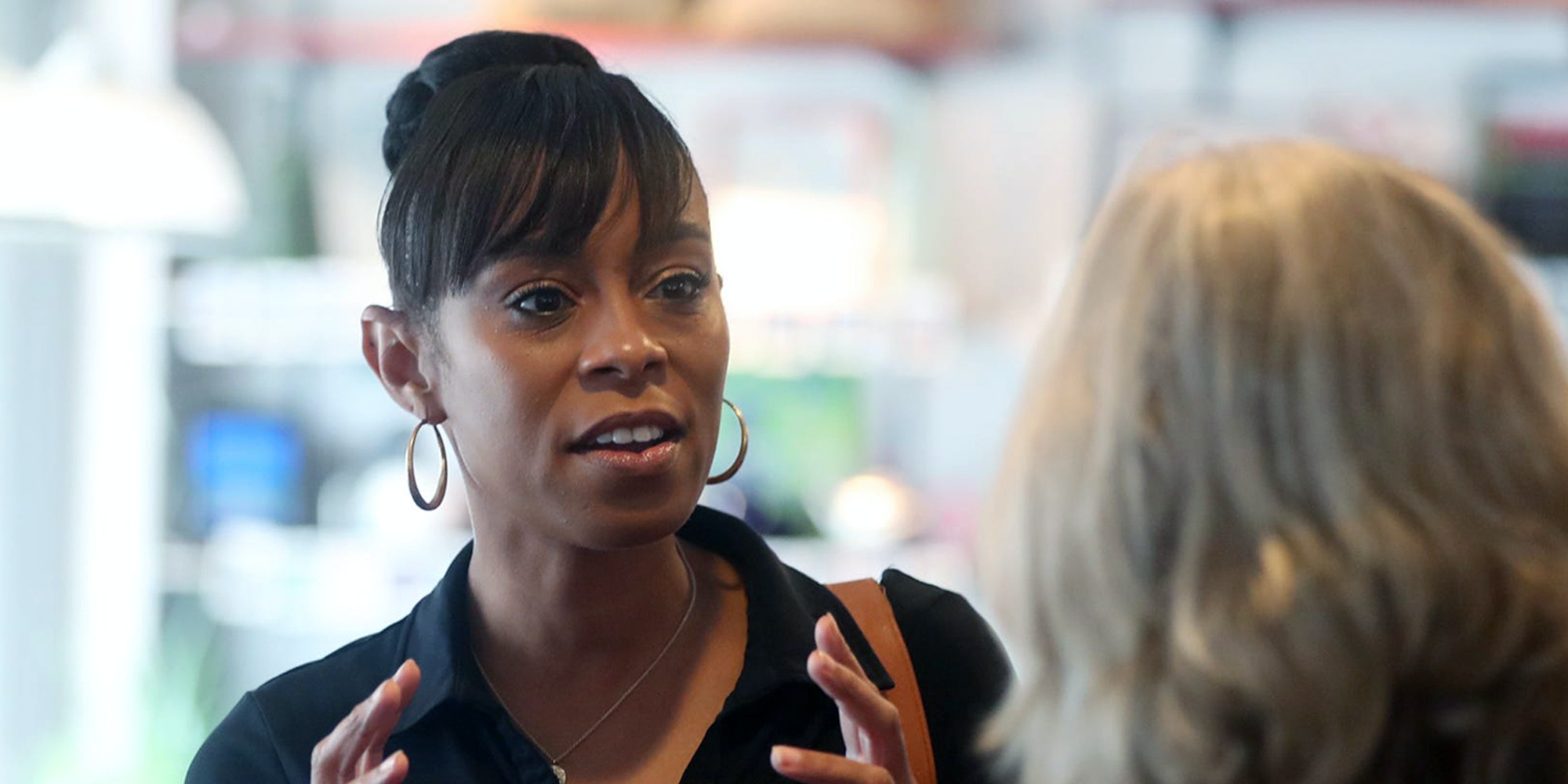 Shontel Brown, candidate for the OH-11 Congressional District, talks with Nancy Holland, Akron city council ward 1, at Angel Falls Coffee shop during a campaign stop in Akron on Wednesday July 14, 2021.Shontel Brown 3