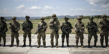 American and Colombian soldiers stand during multinational military exercises at the Tolemaida Air Base in Tolemaida, Colombia, on Sunday, Jan. 26, 2020.