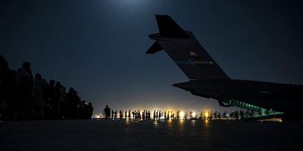 U.S. Air Force troops assist evacuees at Hamid Karzai International Airport in Kabul on Aug. 21, 2021.