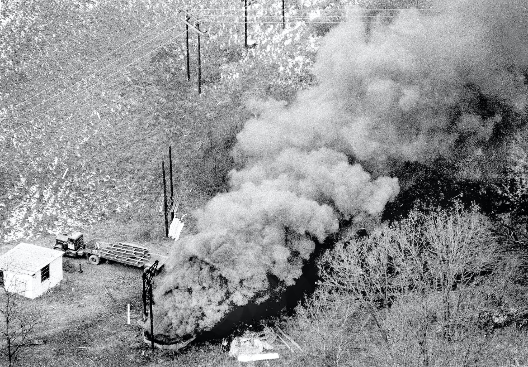 Heavy dense black smoke pours from the Mod's Run air vent where 78 miners are entombed near Farmington, W.Va., Nov. 21, 1968. Twenty-one other miners made their way to the surface after an explosion yesterday. (AP Photo)