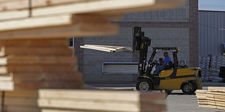 A worker operates a forklift to move trusses at Burton Lumber in Salt Lake City, Utah, U.S., on Thursday, May 6, 2021. U.S.lumber futuresextended their steep rally to fresh record highs, shooting above $1,500 as sawmills try to keep up with surging demand. Photographer: George Frey/Bloomberg via Getty Images
