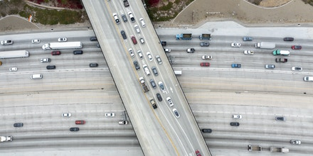 CORONA, CA - May 20: An aerial view of traffic on the 91 Freeway and the Green River Rd. overpass where there have been more than a dozen instances of cars having their windows shot out by bebe guns. Photo taken Thursday, May 20, 2021 in Corona, CA. At least four vehicles were shot at in Anaheim Thursday morning near the WB 91 Freeway. The windows of three cars were shot out on the 91 Freeway in Corona recently, the latest in a string of dozens of similar incidents, according to the California Highway Patrol. The CHP is now investigating roughly 50 shooting incidents that began in late April and have targeted cars traveling on the freeway in Riverside, Orange and Los Angeles counties. (Allen J. Schaben / Los Angeles Times via Getty Images)