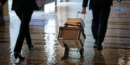 WASHINGTON, DC - AUGUST 02:  Documents, including text of the bipartisan infrastructure legislation, is wheeled toward the office of Senate Majority Leader Chuck Schumer (D-NY) at the U.S. Capitol on August 2, 2021 in Washington, DC. The bipartisan group of senators finalized the legislative text of the $1 trillion infrastructure bill over the weekend and will now move on to the amendments process this week. The legislation will fund projects for improvements to roads, bridges, dams, climate resiliency and broadband internet. (Photo by Drew Angerer/Getty Images)