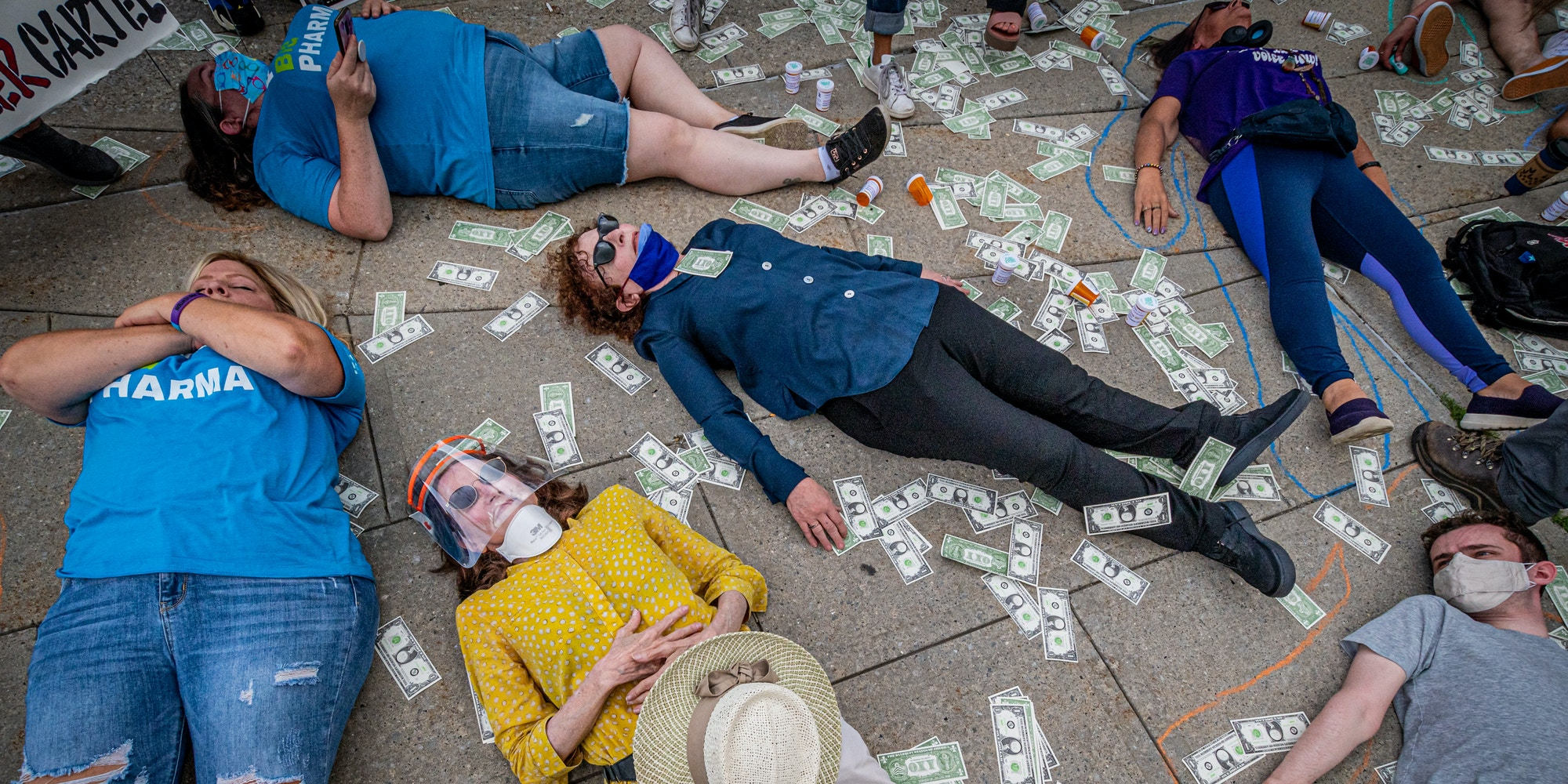 A coalition of survivors and advocacy groups are seen staging a die-in protest outside of The United States Bankruptcy Court, to call out the United States justice system for failing to hold the billionaire Sackler Family to account, in White Plains, N.Y. on Aug. 9, 2021.